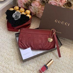 Gucci heart charm Valentine's Day clutch